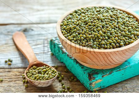 Green Mung Beans In A Bowl And Wooden Spoon.