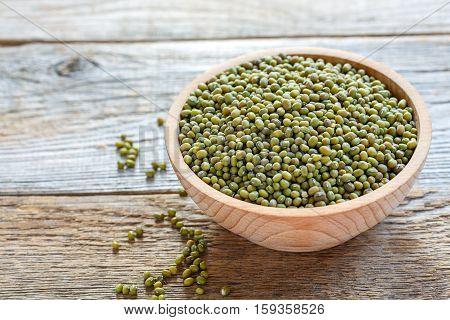 Wooden Bowl Of Green Mung Beans.