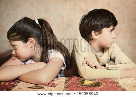 brother and sister after quarrelling argue close up photo