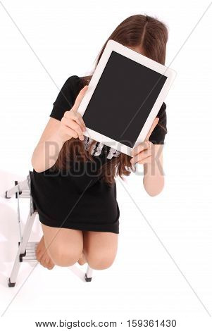 Student teenage girl sitting on the ladder with digital tablet making selfie isolated on white