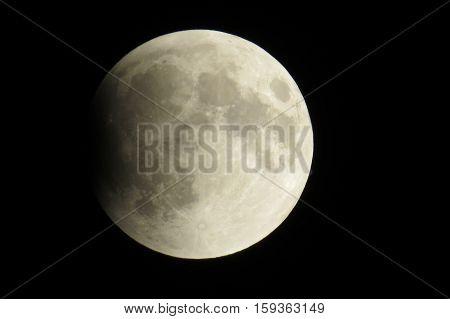 Beginning of a full lunar eclipse in a dark sky