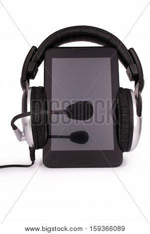 Black tablet PC and headphones isolated on white background. Clipping path included