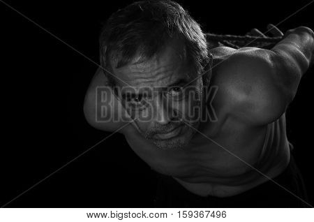 Man with hands tied behind their backs.