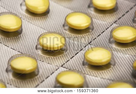 a lot of yellow pills in the package