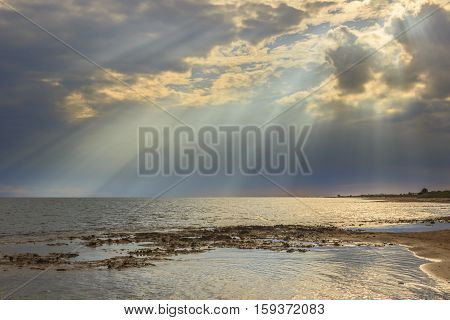 Apulia coast: horizon sea with cloudy sunset. Salento,ITALY. Typical beach with sandy coves and cliffs from Torre Pali to Pescoluse.