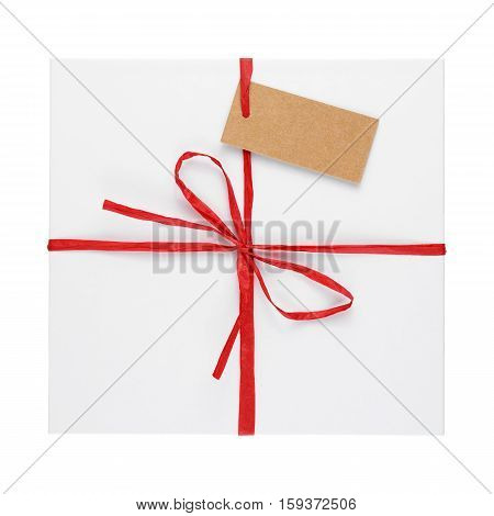 Gift box top view with tag isolated on white background