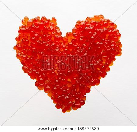 Heart made of red caviar. Small red kechuzh' roe laid in the form of heart. Delicious! And it is a symbol of the New Year and Valentine's Day.