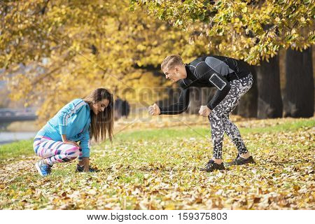 A Man Encourage His Woman To Keep Going. Beautiful Lady Feels Tired. Autumn Environment.