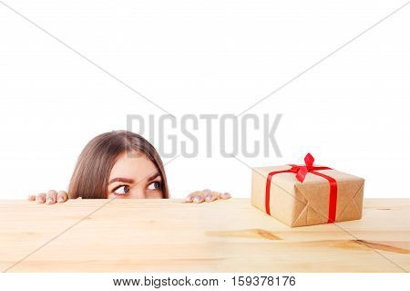 surprised woman looks at a gift box. Christmas, x-mas, winter, happiness concept
