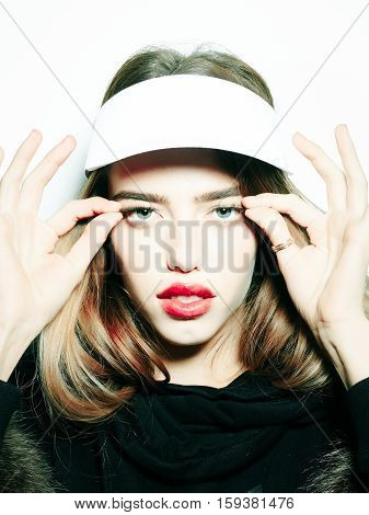 Pretty girl cute sexy young beautiful woman brunette female fashion model in cap peak visor pulls eyelashes isolated on white