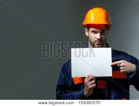 Serious Man Keeps Blank Paper