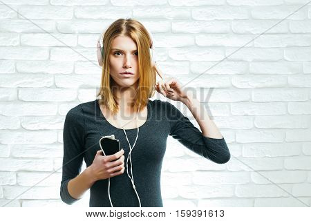 Pretty Girl With Headset And Phone
