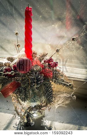 Dusty Christmas decoration all covered in cobwebs forgotten on the windowsill