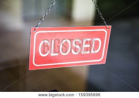 Close-up Of Closed Tag Inside The Window Shop
