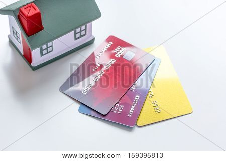 toy house, credit cards - concept mortgage on white background close up