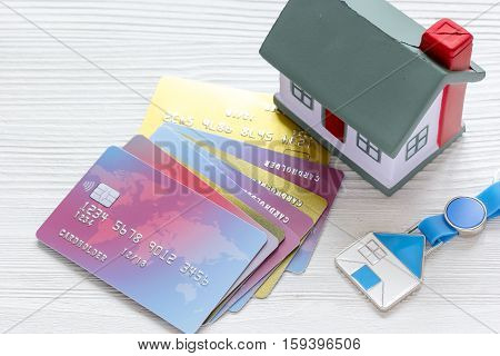credit cards concept - mortgag for new home on wooden background