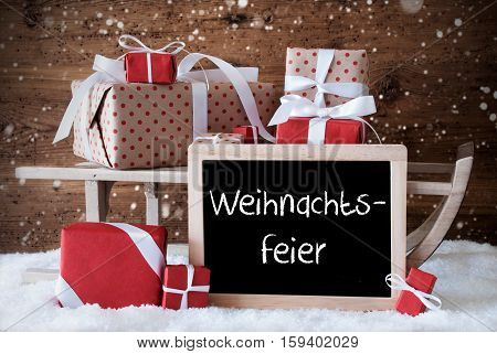 Chalkboard With German Text Weihnachtsfeier Means Christmas Party. Sled With Christmas And Winter Decoration And Snowflakes. Gifts And Presents On Snow With Wooden Background.