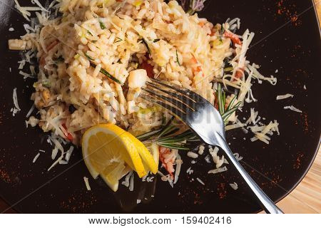 Risotto With Seafood On A Wooden Background.