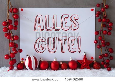 Label With German Text Alles Gute Means Best Wishes. Red Christmas Decoration Like Balls On Snow. Urban And Modern Cement Wall As Background.
