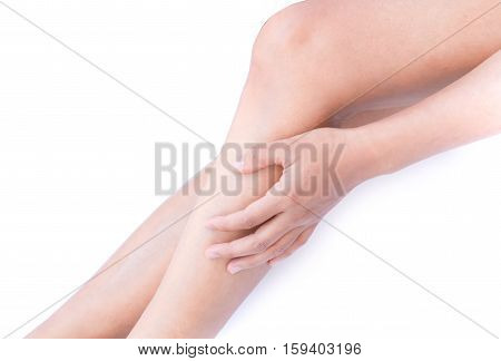 Woman hand touch her legs for Skin care and beauty concept