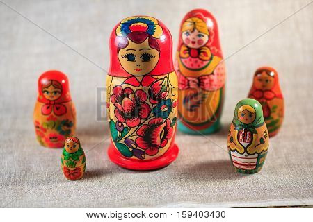 Russian dolls. Matryoshka on linen fabric for the background.