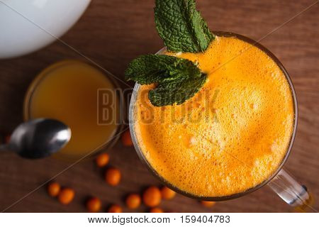 Buckthorn Juice In A Glass With Honey