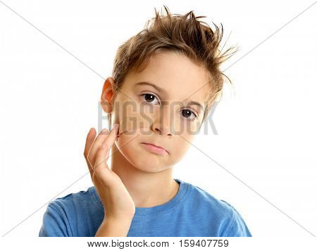 Cute little boy with sticking plaster on cheek, on white background