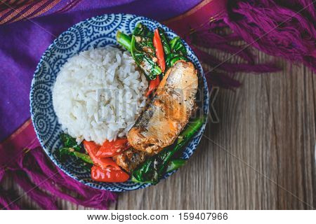 Stir Fried Chinese Kale with Canned fish on Thai Fabric and Old Wooden Background Thai Food Thai Cuisine Thai Famouse Food