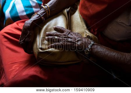 Bag in old woman hand at the train in Sri Lanka