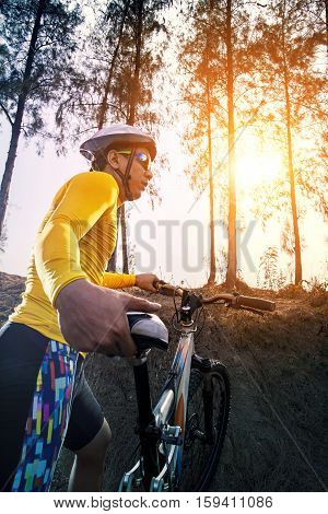 young man and mountain bicycle against sun light for people sport outdoor activity