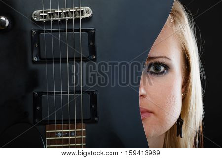 Blonde Woman Holding Electric Guitar, Black Background