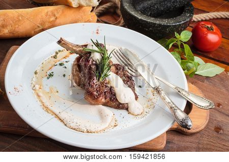 Lamb Rack On Wooden Table And Ingredients
