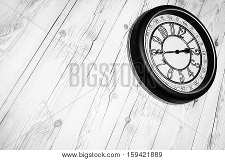Wooden panel plank vintage style with clock stuck wall. Brown wood texture. Desk nature pattern background. Dark table top floor. Beech stage hardwood. Home design. Timber surface vintage for staging.