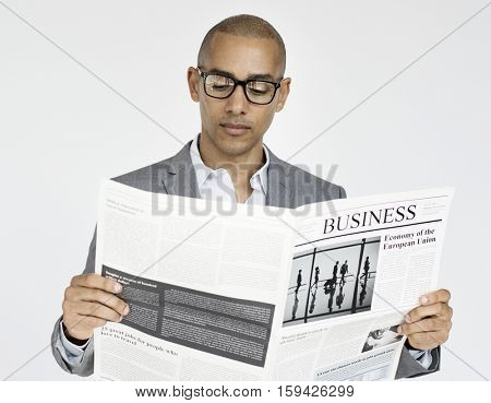 Businessman Reading Newspaper Article Journal Concept