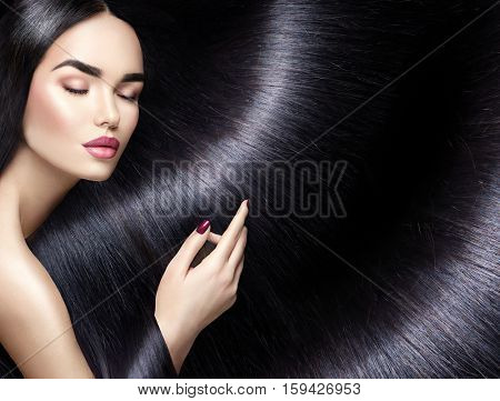 Beautiful long Hair. Beauty woman with luxurious straight black hair as background. Beautiful brunette Model girl touching Healthy Hair. Lady with long smooth shiny straight hair. Hairstyle Cosmetics