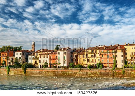 Old Houses On Waterfront Of The Adige River, Verona, Italy