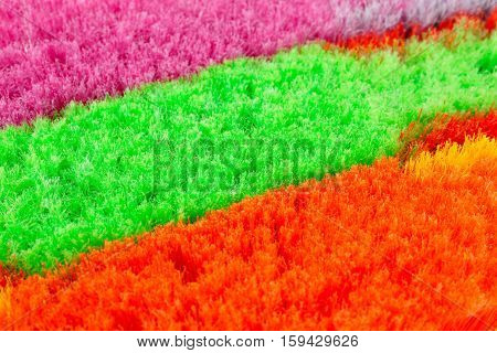 Three colorful brooms close up horizontal picture.