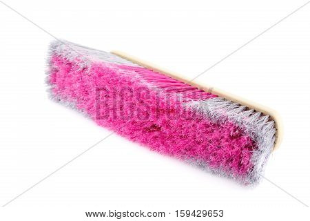 Colorful broom isolated on white background, close-up picture.