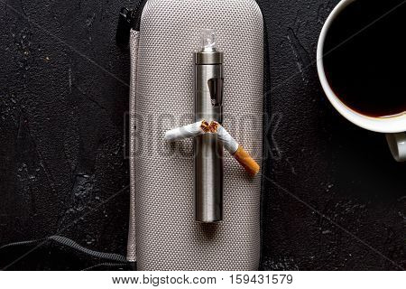 concept of electronic cigarette on dark background top view.