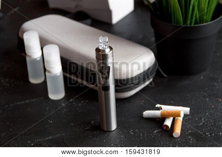 concept of electronic cigarette on dark background close up