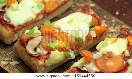 Bread Pizza Sprinkled With Spring Onion On White Plate