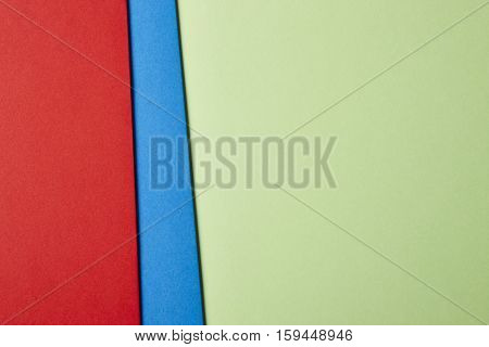Colored cardboards background in red blue green. Copy space. Horizontal