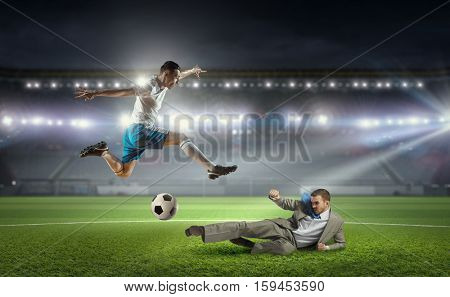Businessman playing soccer . Mixed media