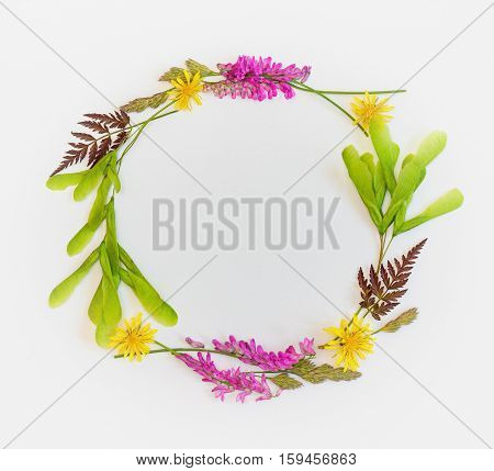 The wreath of wildflowers. Summer frame with wildflowers. Place for a replica. The top view.