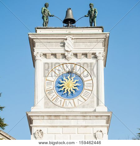Clock tower with bell and robots to play it. In The city of Udine Italy