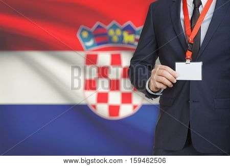Businessman Holding Name Card Badge On A Lanyard With A National Flag On Background - Croatia