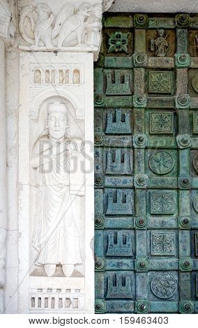 Casauria,  Italy - August 20, 2006:  Detail of the main portal of the St. Clemente basilica