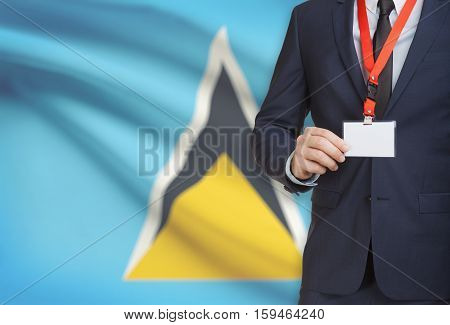 Businessman Holding Name Card Badge On A Lanyard With A National Flag On Background - Saint Lucia