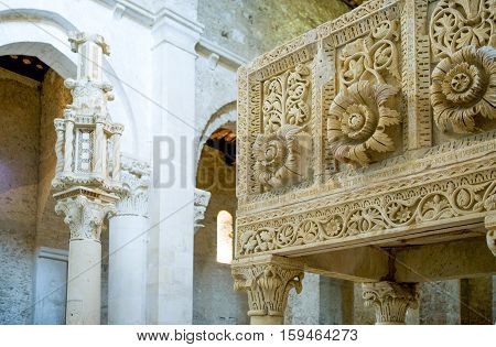 Casauria,  Italy - August 20, 2006:  The inside of the St. Clemente basilica, detail of the pulpit