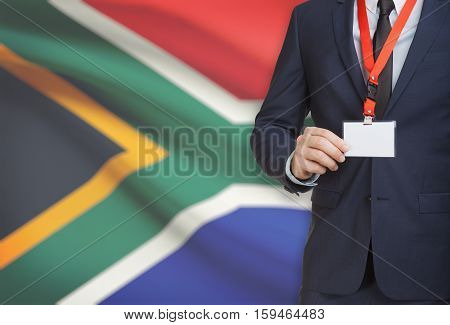 Businessman Holding Name Card Badge On A Lanyard With A National Flag On Background - South Africa